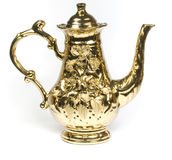 Beautiful gold coffee pot. With an ornament on a white background stock image