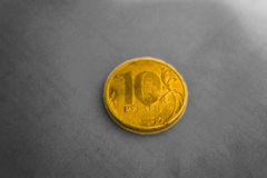 Beautiful gold coin 10 Russian rubles. On the table Royalty Free Stock Image
