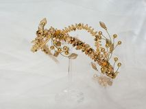 Beautiful gold crown on a grey background royalty free stock images