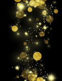 Beautiful gold glittering stars and star dust. Gold effect pixie dust on black. Bokeh golden background with shining sparkles and sand. Vertical festive glitter Royalty Free Stock Photo