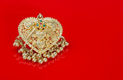 Beautiful Gold Heart Pendant on a Red Background Stock Photography