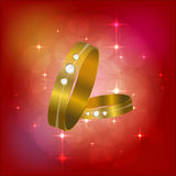 Beautiful gold jewelry with diamonds. defocused red background. Wedding rings . Vector illustration . vector illustration