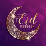 Beautiful gold moon eid mubarak festival greeting background Stock Photo