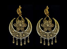 Beautiful gold ornaments on a dark background. jewelry for women. necklace and earrings Stock Images