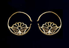 Beautiful gold ornaments on a dark background. jewelry for women. necklace and earrings Stock Photos