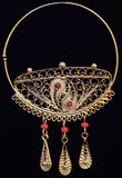 Beautiful gold ornaments on a dark background. jewelry for women. necklace and earrings Stock Photography