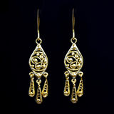Beautiful gold ornaments on a dark background. jewelry for women. necklace and earrings Royalty Free Stock Image