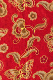 Beautiful gold pattern on red batik Stock Images