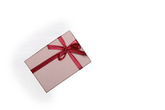 Beautiful gold present box with red bow and ribbons on backgound Stock Photography