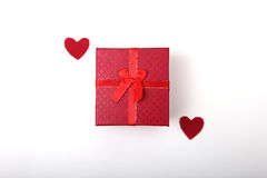 Beautiful gold present box with red bow and ribbons on backgound Stock Images