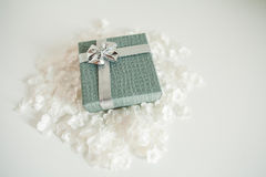 Beautiful gold present box with red bow and ribbons on white backgound Stock Photos