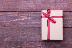 Beautiful gold, red present gift box and ribbons on backgound Stock Photo