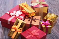 Beautiful gold, red present gift box and ribbons on backgound Stock Image