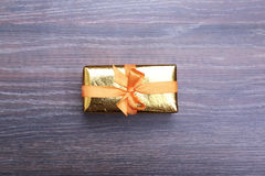 Beautiful gold, red present gift box and ribbons on backgound Stock Images