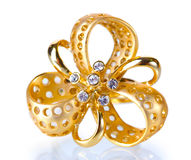 Beautiful gold ring with precious stones. Over the white Royalty Free Stock Image