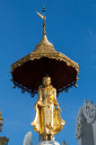 Beautiful gold statue on top of a temple Stock Image