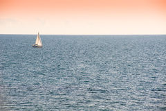 Beautiful gold sunset with a sailboat sailing. Sea. Yacht. Royalty Free Stock Photo