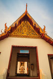 Beautiful golden artwork on the gable end and golden pillar of b Royalty Free Stock Photography