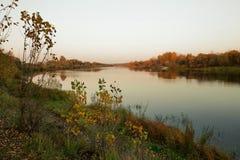 Beautiful golden autumn. evening by the river. Stock Photos