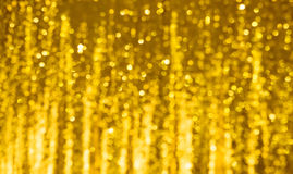 Beautiful golden Background with bokeh lights. Royalty Free Stock Photography