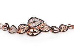 Beautiful golden bracelet with precious stones Royalty Free Stock Photo