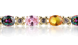 Beautiful golden bracelet with precious stones Royalty Free Stock Image