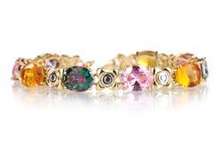 Beautiful golden bracelet with precious stones Stock Photo