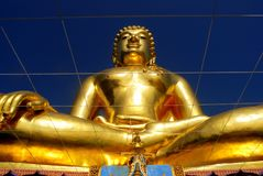 Beautiful Buddha statue in the Thai Buddhist temple. Beautiful Golden Buddha statue, against blue sky background, in the Thai Buddhist temple Stock Photos