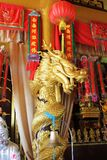 Beautiful Golden Buddhist statue dragon with a red cloth. View Royalty Free Stock Photography