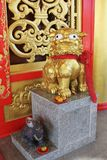 Beautiful Golden Buddhist statue with a red cloth. View Royalty Free Stock Photo