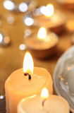 Beautiful golden candles. Christmas eve mood Stock Photo