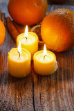 Beautiful golden candles on wooden table. Stock Images