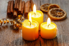 Beautiful golden candles on wooden table. Royalty Free Stock Photography