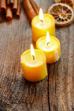 Beautiful golden candles on wooden table. Royalty Free Stock Image