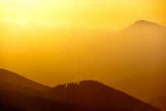 Beautiful golden color of sunset in the mountains Stock Image