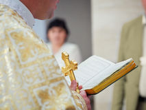 Beautiful golden cross in male hands of priest Royalty Free Stock Photo