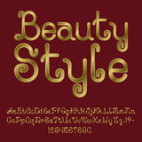 Beautiful golden curly font.  english alphabet. Of capital and lowercase letters with numbers and punctuation marks. Beauty Style text lettering Stock Photos
