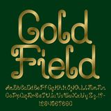 Beautiful golden curly font. Isolated english alphabet of capital and lowercase letters with numbers. And punctuation marks. Gold Field text lettering Royalty Free Stock Photos