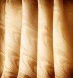 Beautiful golden curtains Stock Photo