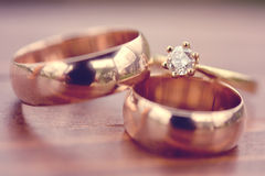 Beautiful golden engagement and wedding rings Royalty Free Stock Image