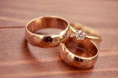 Beautiful golden engagement and wedding rings Stock Images