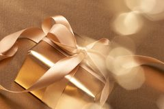 Beautiful golden gift Stock Images