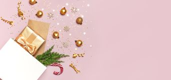 Free Beautiful Golden Gift White Paper Bag Confetti Stars Christmas Balls On Pink Background Top View Flat Lay. New Year Presents Royalty Free Stock Photos - 165041508