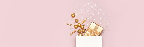 Free Beautiful Golden Gift White Paper Bag Confetti Stars Christmas Balls On Pink Background Top View Flat Lay. New Year Presents Stock Photo - 165041560