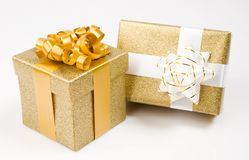 Beautiful golden gifts Stock Photography