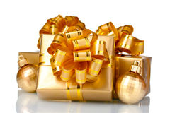 Beautiful golden gifts and Christmas balls Royalty Free Stock Photos