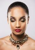 Beautiful golden glamour woman Stock Image