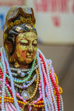 Beautiful golden guan yin statue with full of pearl necklace. Royalty Free Stock Photography