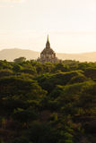 Beautiful golden hour sunset with ancient temple, Bagan Stock Image