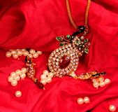 Beautiful Golden Indian necklace in red background Royalty Free Stock Images